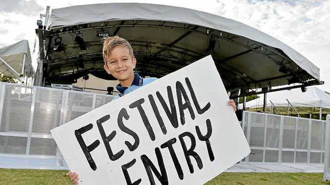 READY TO ROCK: Seven-year-old Isaiah Buchanan gets a sneak preview of the stage area ahead of Originals Music Festival.