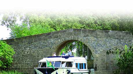 The Canal Du Midi can present some tight challenges on the way, but it's all part of the adventure when you tour southern France by motor launch.