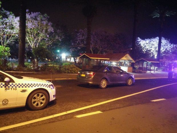 A police vehicle alongside a taped-off Market Square in Grafton after a violent incident that put two men in hospital.