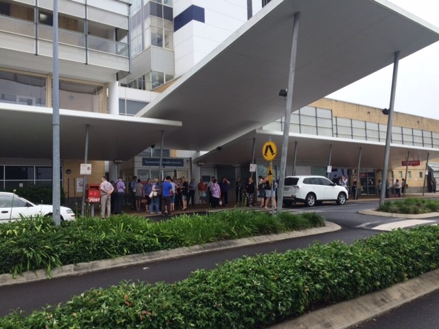 Staff gather outside the Toowoomba Hospital after a bomb threat was received this morning.