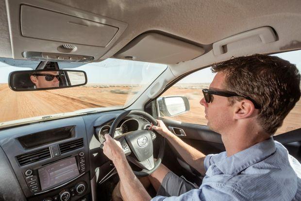 Iain Curry driving the Mazda BT-50 through the South Australian Outback. Photo: Thomas Wielecki
