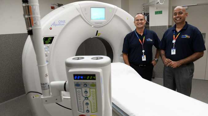 MEDICAL IMAGING: WBHHS chief executive Adrian Pennington and WBHHS director of medical imaging Michael Samuel with the new CT Scanner at the Bundaberg Hospital. Photo: Mike Knott / NewsMail