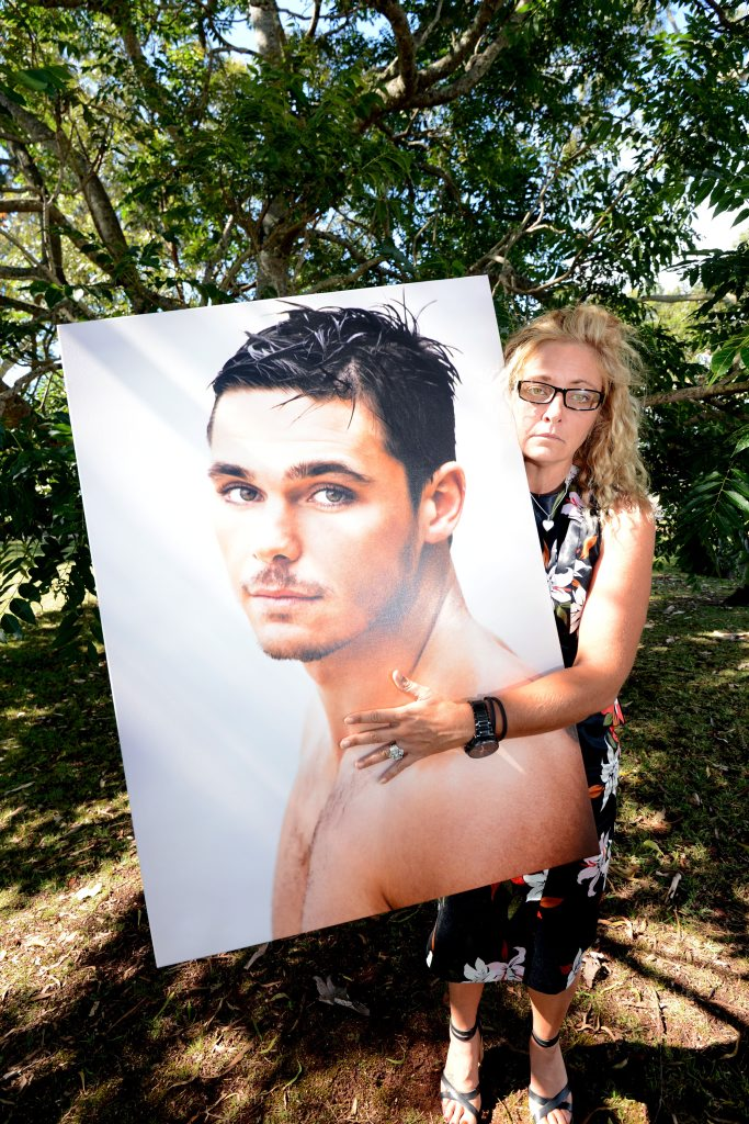 Jodie McNaughton with a portrait of her son Rhys, taken by John Bortolin. Photo Cathy Adams / The Northern Star