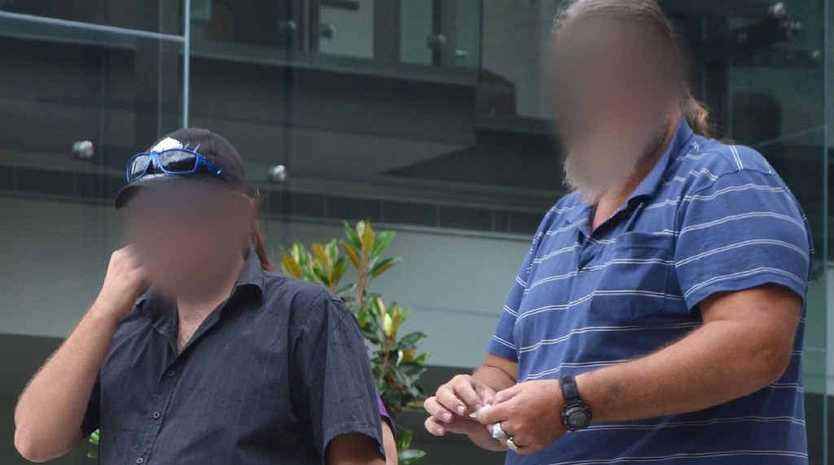 An Ipswich dad and his adult son have faced court for assaulting a 13-year-old boy.