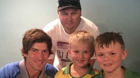 Aussie opener Joe Burns meets Ipswich's up and coming cricketers Jake McPhail and Blake Colburn. Also pictured is Jake's dad Wayne.
