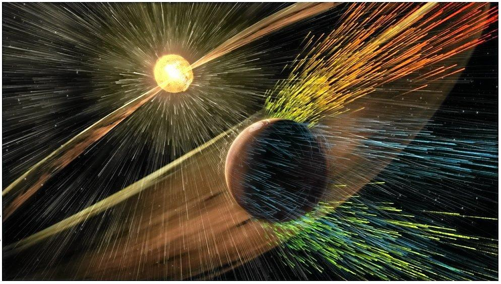 Artist's rendering of a solar storm hitting Mars and stripping ions from the planet's upper atmosphere.Credits: NASA/GSFC