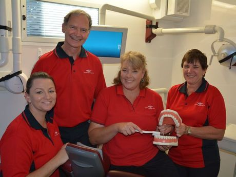 Dentist Plessis van der Merwe, from Toowoomba, with dental assistants Monique Slade, from Woolooga near Gympie, Jo Conway from Goodnight Scrub near Childers and Sharon Rossetto, from Townsville in the QCoal Community Dental Service van. Photo: Rae Wilson