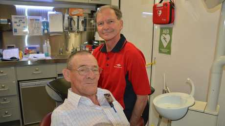 Patient Bill Tucker, from Sapphire, at the dentist for the first time in 60 years. The QCoal Community Dental Service is run by Royal Flying Doctor Service staff. Photo: Rae Wilson