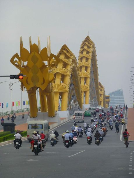 The Dragon Bridge over the River Han at Da Nang dominates the skyline.