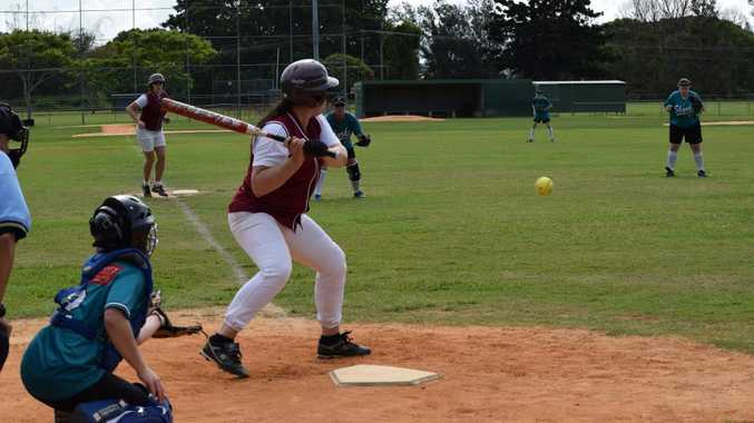 Dodgers Devils player Sonya Pope taking a swing during Saturday's softball match at Albert park in Lismore between the Dodgers Devils and the Ballina Sharks.