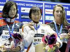 Jessica Hobbin (right) with Japanese medallists Miki Uchida (silver) and Rikako Ikee (gold) in Tokyo.