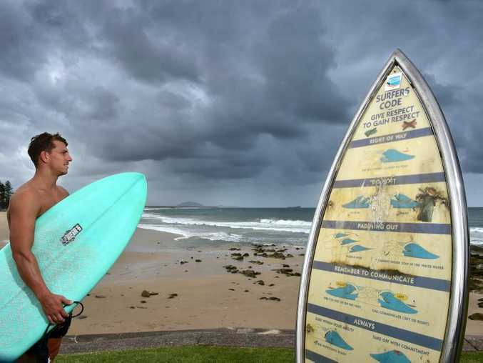 A sign at Alexandra Headland provides surfers with a rundown of the basic surf code of respect.