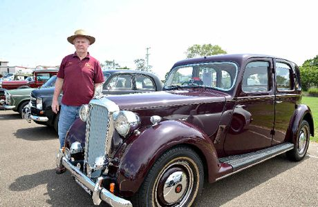 CARS WITH CHARACTER: Derrick Smith displays his 1949 Rover P375.