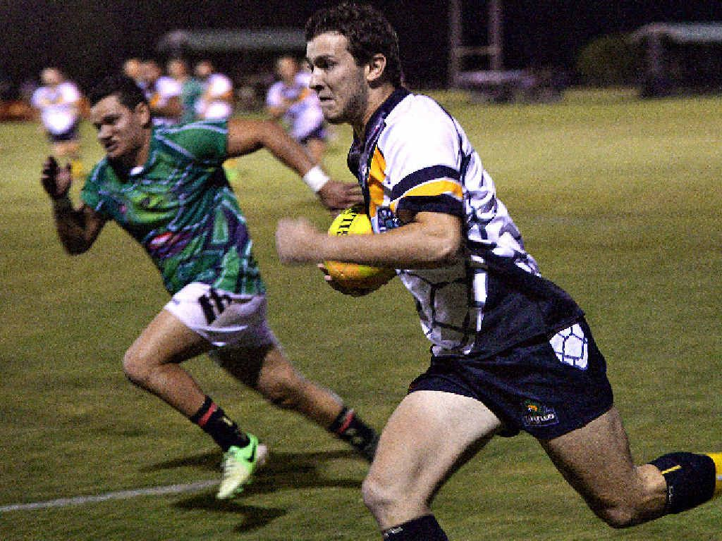 ON THE FLY: Pythons' Connor Jones breaks clear of Turtles' Geoff Prizeman at Across the Waves on Friday.
