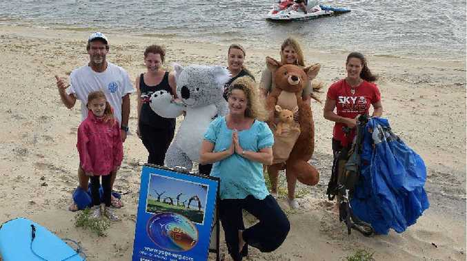 ACTION PACKED: Ben Silk from Silky Surf School with his daughter Luana, Alana Hall, Romy Glesk and Jodie Prime (right) from Sunshine Coast Skydivers, Erina Kilmore from Australia Zoo and Danielle Mondahl (front) from Yoga NRG want Schoolies to come to the Coast.