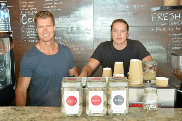 GRIND TIME: Behind The Grind owner Dave Lonie and barista Petter Havnegjerde hard at work.