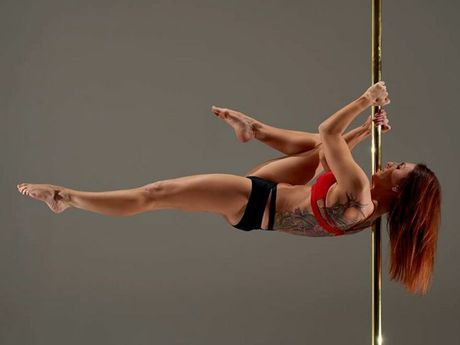 Instructor Sarah at Pure Pole in Toowoomba demonstrates pole dancing for fitness.