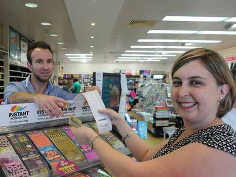BIG WIN: Hoping to score the winning ticket is Emma Burling (right) with Highfields News and Post owner Shaun Brady.