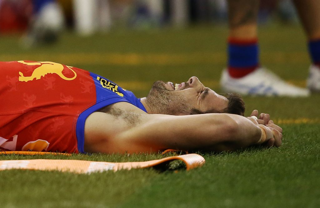 Michael Close reacts in pain after suffering the knee injury at Etihad Stadium in Melbourne last April. Photo: Michael Dodge/Getty Images.
