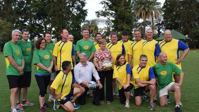 The MPs who made up the country (yellow) and city (green) teams for he annual country versus city MP touch football match with Bruce and Denise Morcombe.