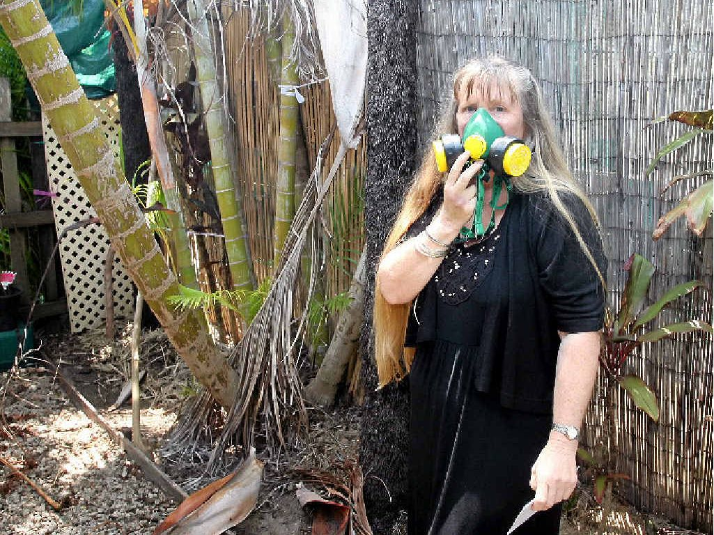 TAKE A BREATH: Carrie-Ann Layton-Smith can not go in here backyard without a mask due to toxins.