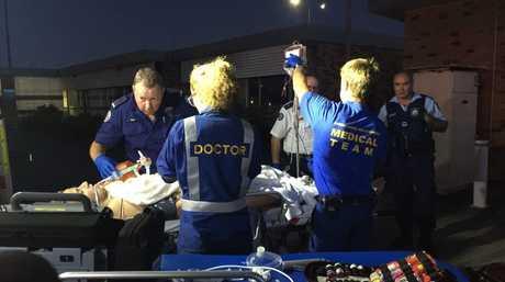 Doctors and paramedics at work on shark attack victim Sam Morgan at Ballina airport where they set up a resuscitation work platform and administered three units of blood.