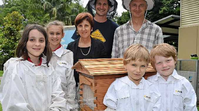 GO WITH FLOW: Main Arm Upper Public School pupils Adel, Bethany, Sonny and Louie with principal Virginia Pavlovich, Bee Inventive's head of IT and support Yari McGauley and parent Dave Osborn with the school's new Flow Hive.