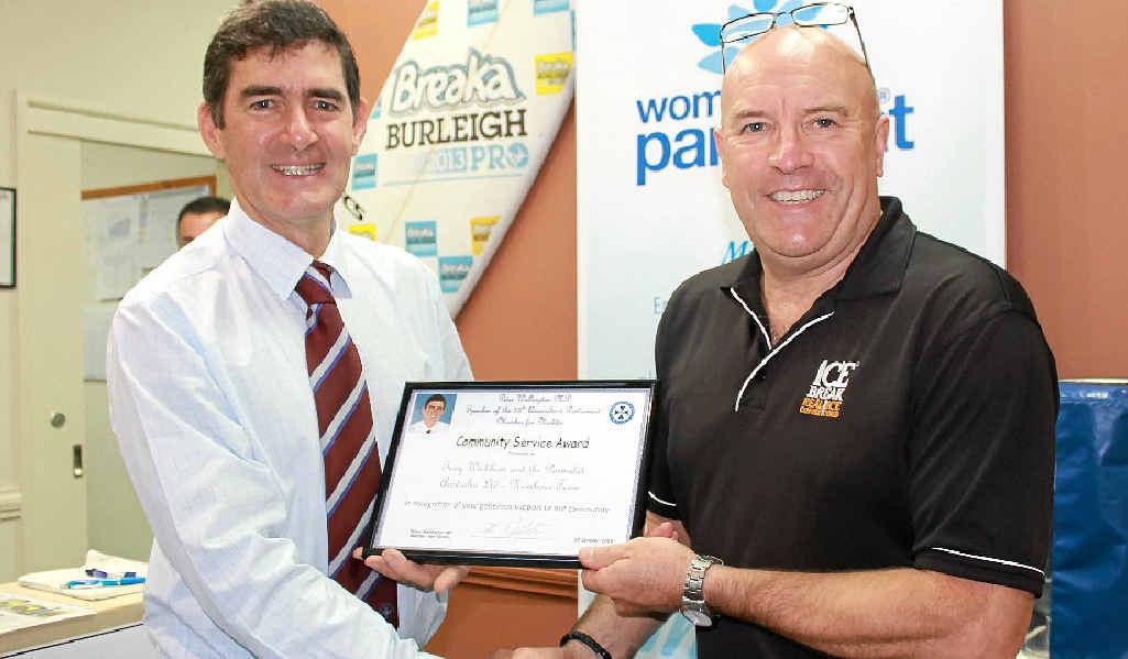 APPRECIATED: Member for Nicklin Peter Wellington presents Parmalat's Tony Wickham with an appreciation certificate.