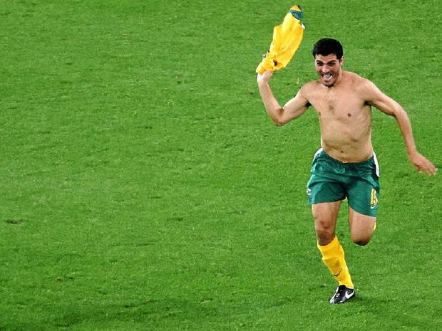 GOOOOOAL: John Aloisi celebrates his winning penalty in the 2006 FIFA World Cup qualifying match between Australia and Uruguay.