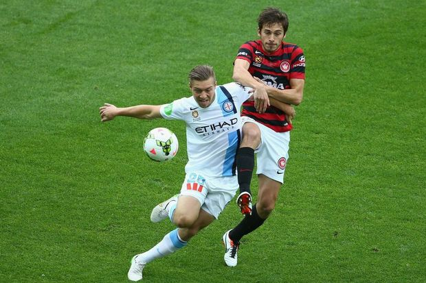 Jacob Melling of Melbourne City is challenged by Mateo Poljak of the Western Sydney Wanderers  at AAMI Park last season. Photo: Robert Cianflone/Getty Images.