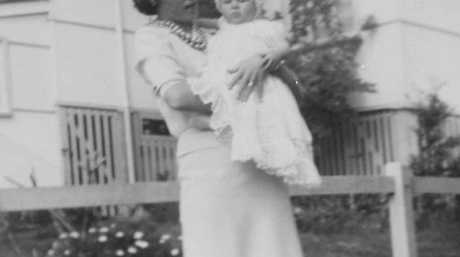 Karen Smith on the day she was christened in 1964 with her mum Lurline. (left) Karen with her daughter Melissa.