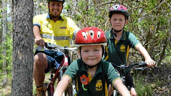 Six-year-old Kyogle local Ewan Wilkie testing out the first few metres of the new mountain bike trail network under construction in Boorabee State Forest, a short drive out of town, in front of brother Finn, 8, and dad Reid.