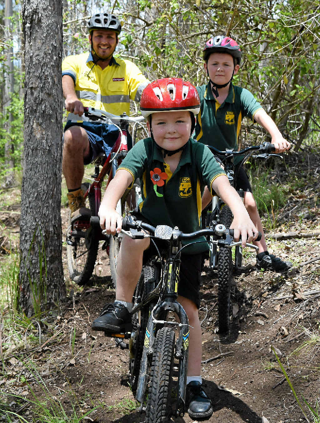 Six-year-old Kyogle local Ewan Wilkie testing out the first few metres of the new mountain bike trail network under construction in Boorabee State Forest, a short drive out of town, in front of brother Finn, 8, and dad Reid. Photo: Hamish Broome / The Northern Star