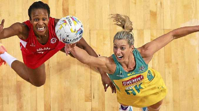 Australian Diamonds captain Laura Geitz competing for the ball with England's Pamela Cookey, left during the Netball World Cup. Geitz will be in Mackay on Monday for clinics with junior players.