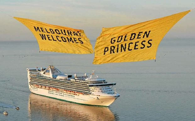 Helicopters carry two giant curtains welcoming the Golden Princess on arrival in Melbourne.