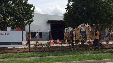 Fire, police and ambulance at the scene of a fire at a factory at the railway workshops in Redbank.