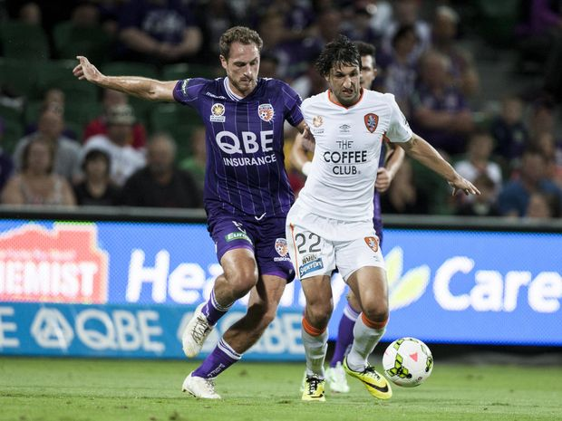 Glory's Rostyn Griffiths and Roar's Thomas Broich contest the ball. Photo: AAP Image/Tony McDonough