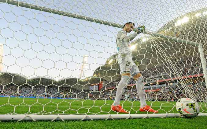 Janjetovic  takes the ball from the back of the nets after the first goal of last season's A-League Grand Final. Photo: AAP Image/Joe Castro