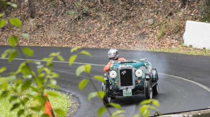OLD TIMER: 1936 Austin 7 Special looks resplendent in full flight up Noosa's hill