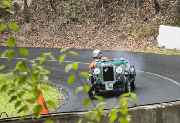 OLD TIMER: 1936 Austin 7 Special looks resplendent in full flight up Noosa's hill