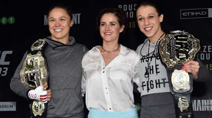 (L-R) UFC fighters Ronda Rousey (left) and Joanna Jedrzejczyk (right) pose for photos with Melbourne Cup winning jockey Michelle Payne on stage at Federation Square in Melbourne. Photo: AAP Image/Julian Smith.