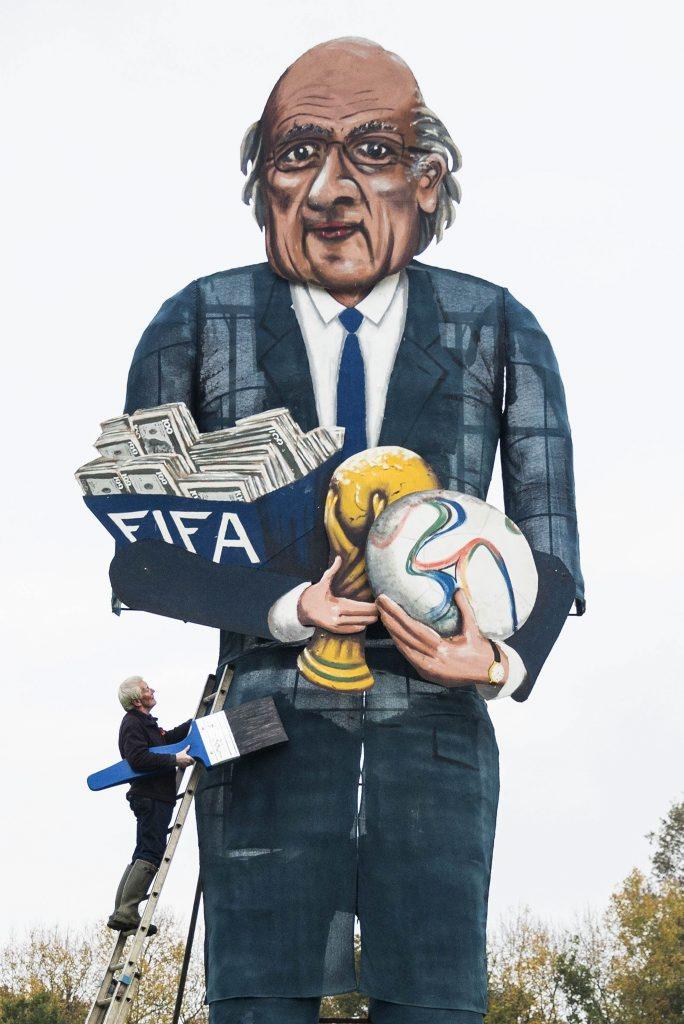 British artist Frank Shepherd with his Sepp Blatter effigy. Photo: AP.