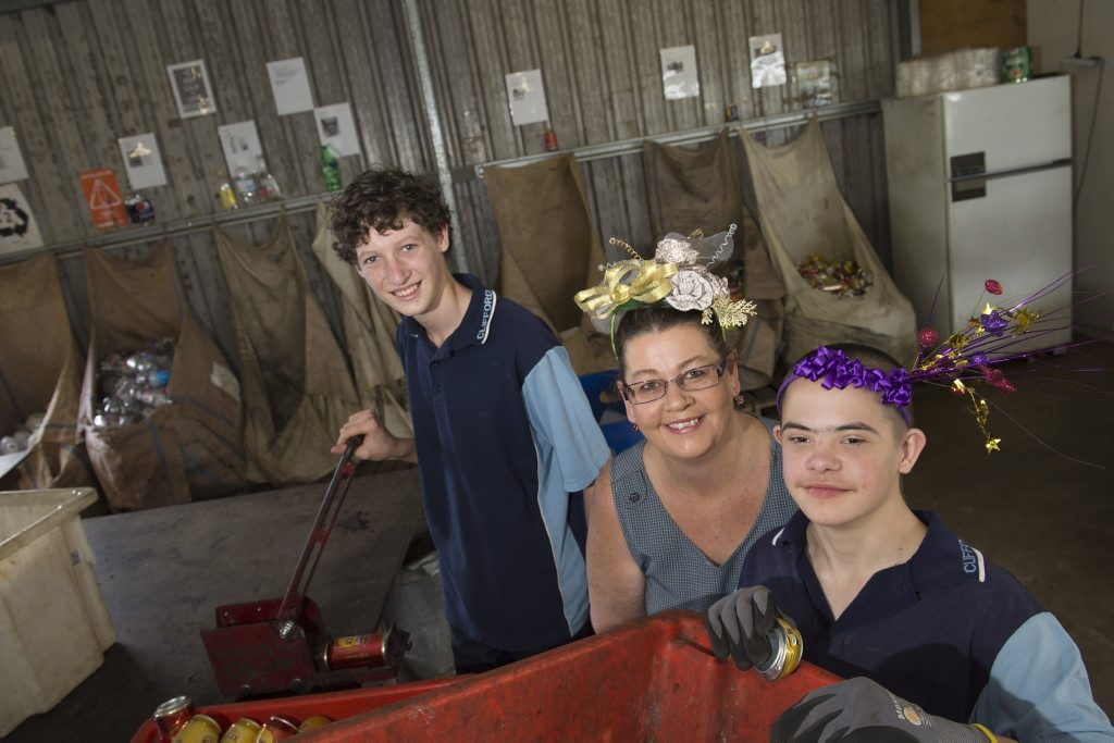 Clifford Park Special School students Harrison Gardner (left) and Braydon Daly with parent and P and C president Kim Daly are fundraising with a race day to build an eight bay shed that will expand their hands-on learning environment with automotive and hospitality service areas, Friday, November 13, 2015. Photo Kevin Farmer / The Chronicle
