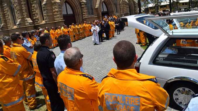 GOODBYE MATE: Hundreds of Rural Firefighters and QFRS workers said goodbye to Neale Michael Dunphy, also known as Wombat, at St Joseph's Cathedral yesterday.