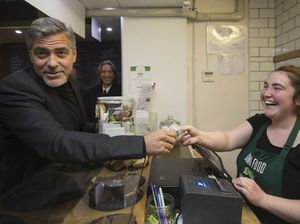 George Clooney visits Social Bite café to help homeless