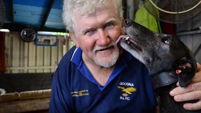 LOVE YA' DAD: Keiron Butler cops a licking from one of his dear pets.