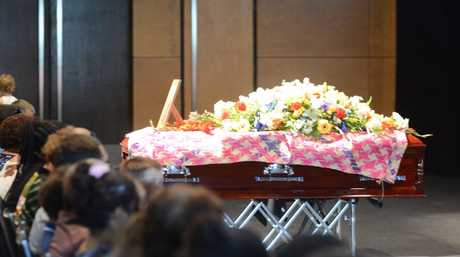 Greg Sutherland's casket was decorated with a Vanuatu Mat, flowers and a photo of the man Photo Troy Kippen / Daily Mercury