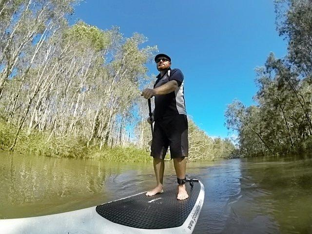 Author Scott Rawstorne stand up paddling while researching his new book.