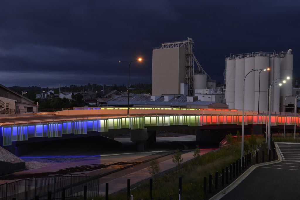 The Victoria St extension of the Outer Circulating Road in Toowoomba is seen lit up in blue, white and red in this composite image as a mark of solidarity with the people of Paris and France following terrorist attacks.