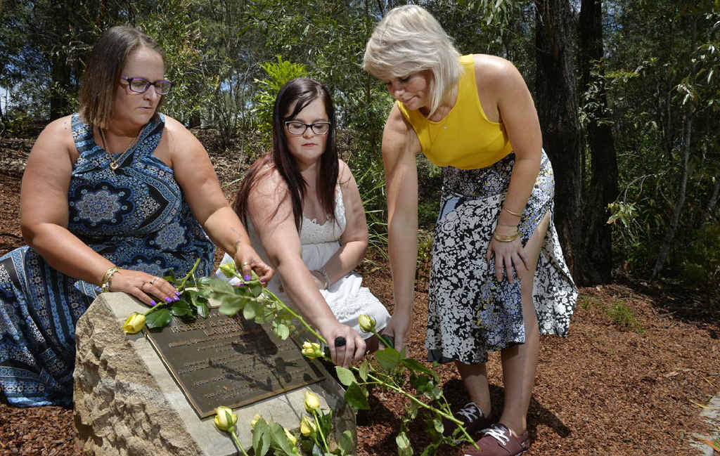 MEMORIES: A plaque at Robelle Domain has been unveiled in memory of MH370 passengers Robert and Catherine Lawton (inset). Pictured are their daughters Glenda Brinckman, Melissa Lawton and Amanda Lawton.